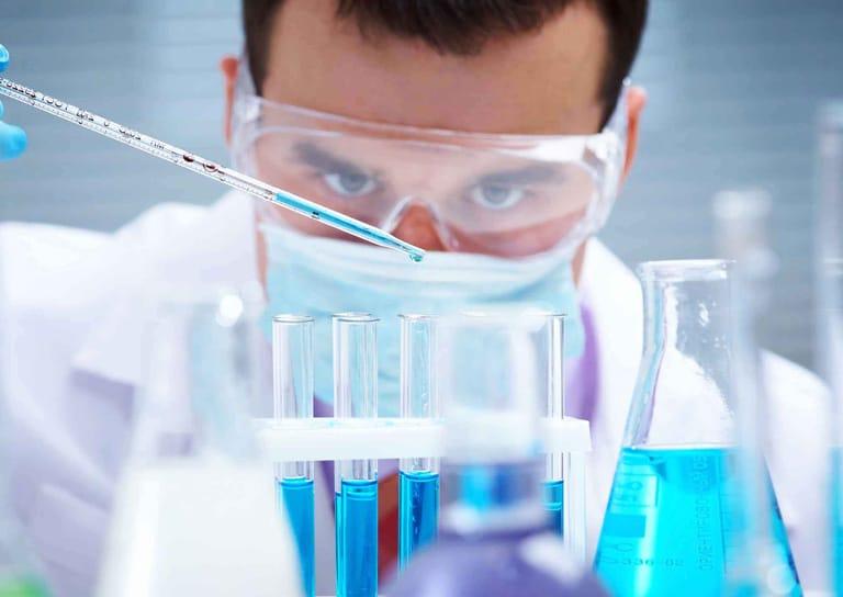 scientist checking chemicals